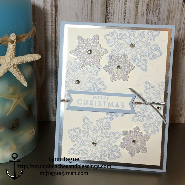 StampinUp Christmas Card made with Flurry of Wishes stamp set, Snow Flurry Punch, Silver Foil Sheets, Dazzling Diamond Glimmer Paper, Rhinestones, designed by demo Lynn Tague. See more cards and gift ideas at BeyondBeachesandBlessings.com #BeyondBeachesandBlessings